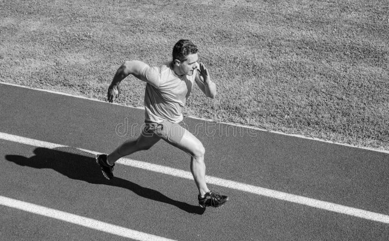 Impulse to move. Athlete run stadium green grass background. Life non stop motion. Runner sporty shape in motion. Sport. Lifestyle and health concept. Man royalty free stock images
