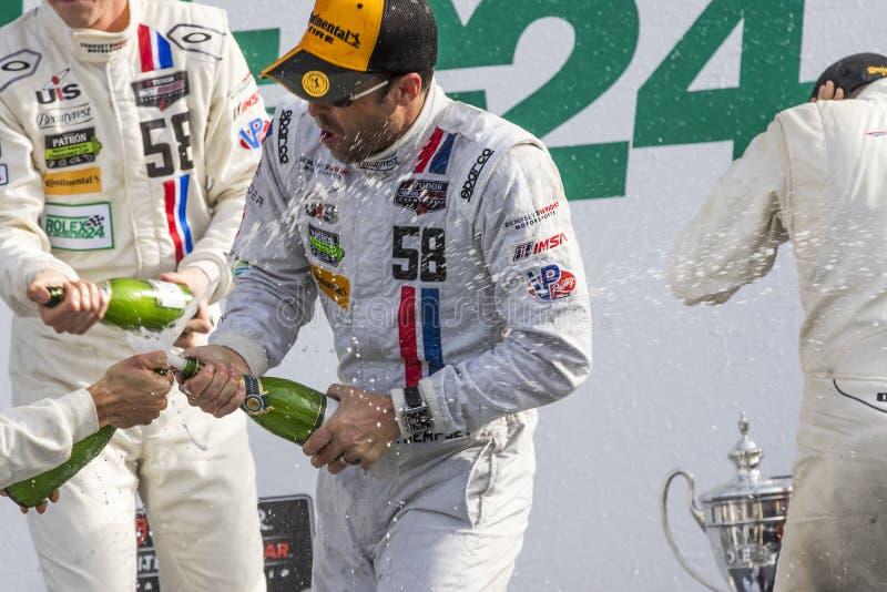 IMSA: Jan 25 Rolex 24. Daytona Beach, FL - Jan 25, 2015: Patrick Dempsey (58) and his team celebrate after winning their division at the Rolex 24 at Daytona stock photos