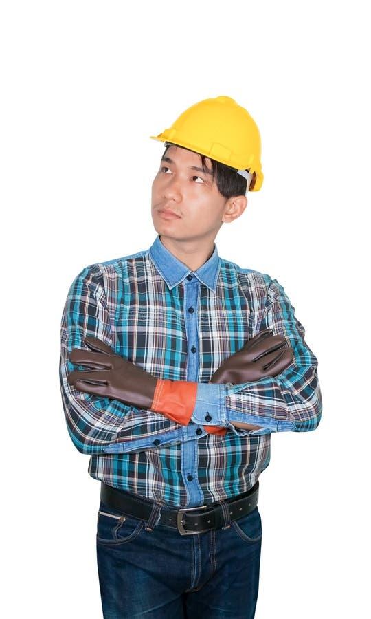 Inżynier budowy mężczyzny główkowania odzież Paskował koszulową błękitną i rękawiczkową skórę z żółtym zbawczego hełma klingeryte obraz stock
