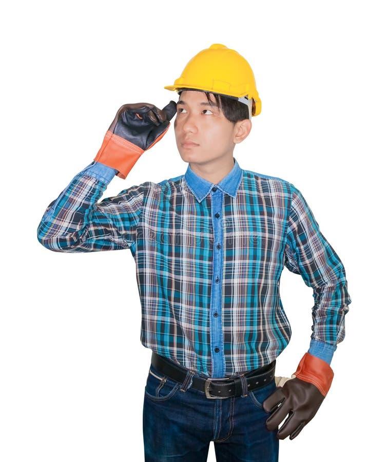 Inżynier budowy mężczyzny główkowania odzież Paskował koszulową błękitną i rękawiczkową skórę z żółtym zbawczego hełma klingeryte obrazy royalty free
