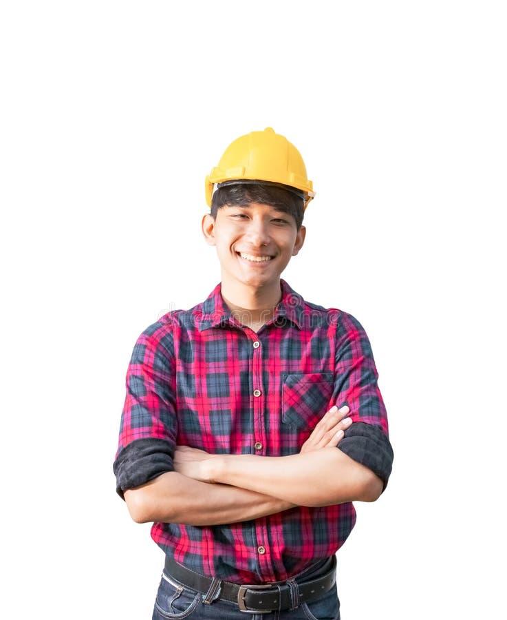 Inżyniera uśmiechu budowy ręki krzyż na klatki piersiowej i odzieży zbawczego hełma żółtym klingerycie na białym tle fotografia royalty free