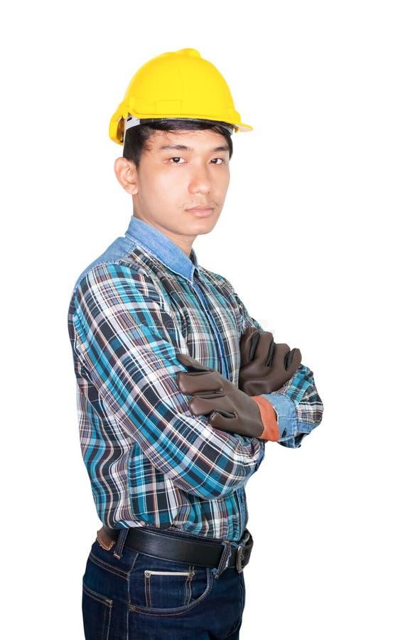 Inżynierii budowy ręki krzyż na klatce piersiowej i odzieży Rzemiennych rękawiczkach z żółtym zbawczego hełma klingerytem odizolo zdjęcia stock