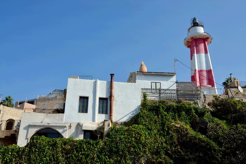 Inactive red and white striped lighthouse in Old Yaffo port Jaffa, Yafo, Tel Aviv, Israel,Middle East. Inactive red and white striped lighthouse in Old Yaffo stock images