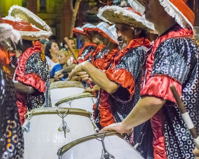 Inagural Parade of Carnival in Montevideo Uruguay. MONTEVIDEO, URUGUAY, JANUARY - 2016 - Costumed men drummers playing traditional music called candombe at the royalty free stock photography