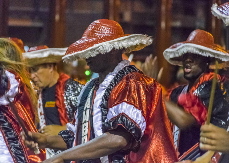 Inagural Parade of Carnival in Montevideo Uruguay. MONTEVIDEO, URUGUAY, JANUARY - 2016 - Costumed men drummers playing traditional music called candombe at the royalty free stock images