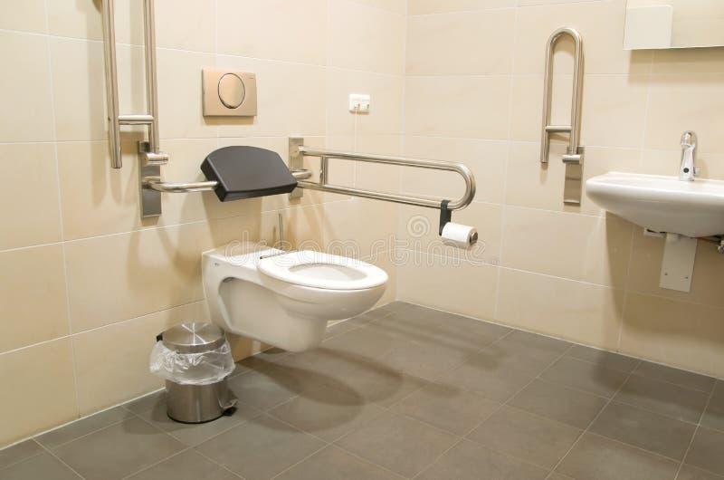 inaktiverat folk för badrum arkivfoto