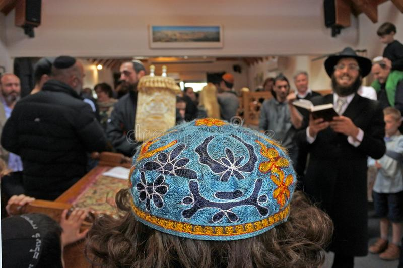 Inauguration of a new Torah scroll ceremony. Jewish people singing and dancing Inside a synagogue during Inauguration of a new Torah scroll ceremony.It is a stock images