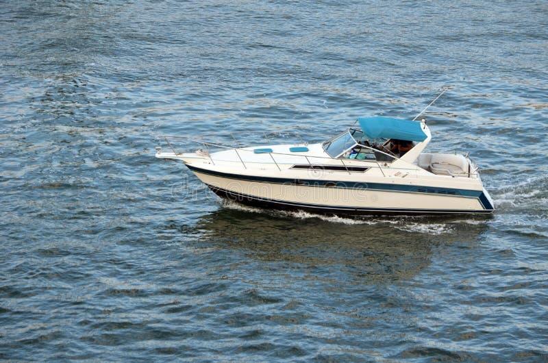 Inboard Motorboat on the Florida Intra-Coastal Waterway. Inboard motorboat cruising the Florida Intra -Coastal Waterway off Port Everglades stock image