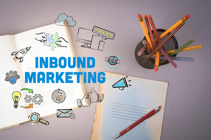 Inbound Marketing concept. Book and pencils stock images