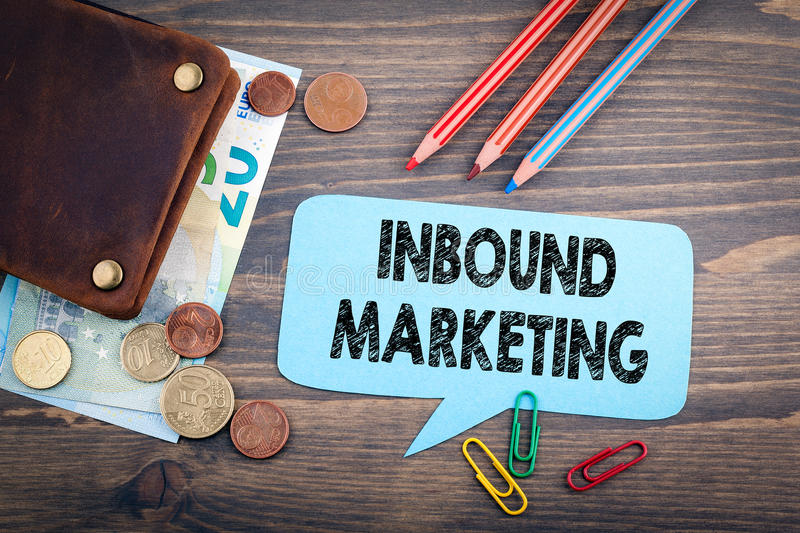 Inbound Marketing concept. Speech Bubble on a dark textured wooden background royalty free stock photography