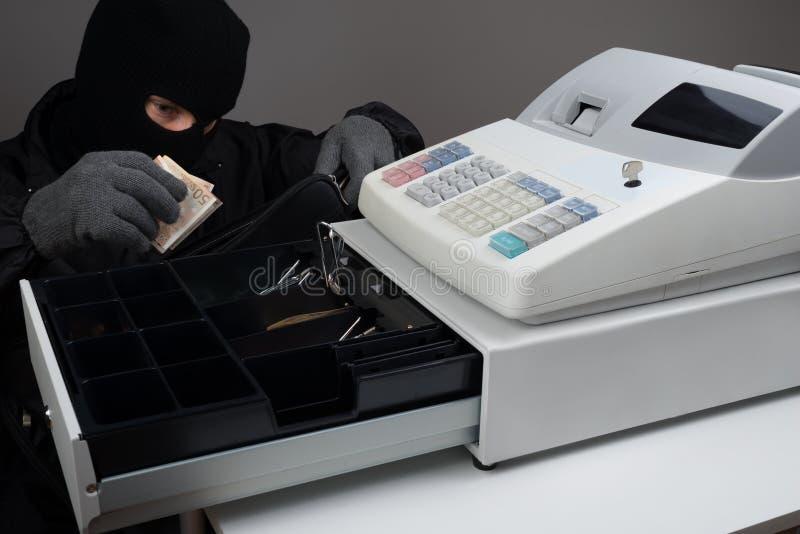 Inbreker Stealing Money royalty-vrije stock foto's