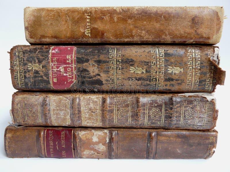 inbundna böcker piskar gammalt royaltyfria bilder
