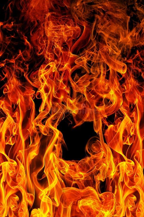 Incêndio no fundo preto fotos de stock royalty free