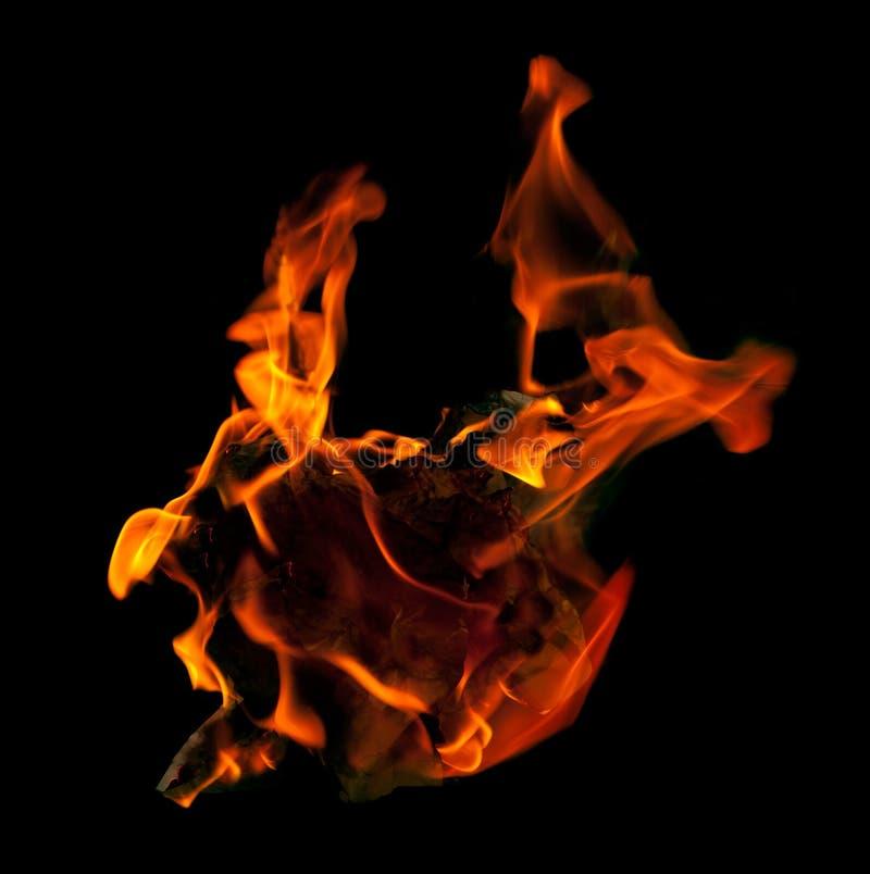 Incêndio que queima-se no papel fotografia de stock