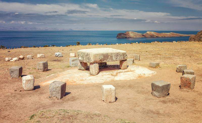 Inca ceremonial table used to be probably place of human sacrifices at Isla del Sol (Island of the Sun) in Titicaca lake, Bolivia. Inca ceremonial table used to stock photos