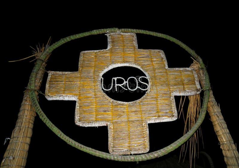 Inca Cross eller Chakanaen, symbolet av de gamla kulturerna av Anderna som göras från den Totora vassen, porten på Uros Islands,  fotografering för bildbyråer