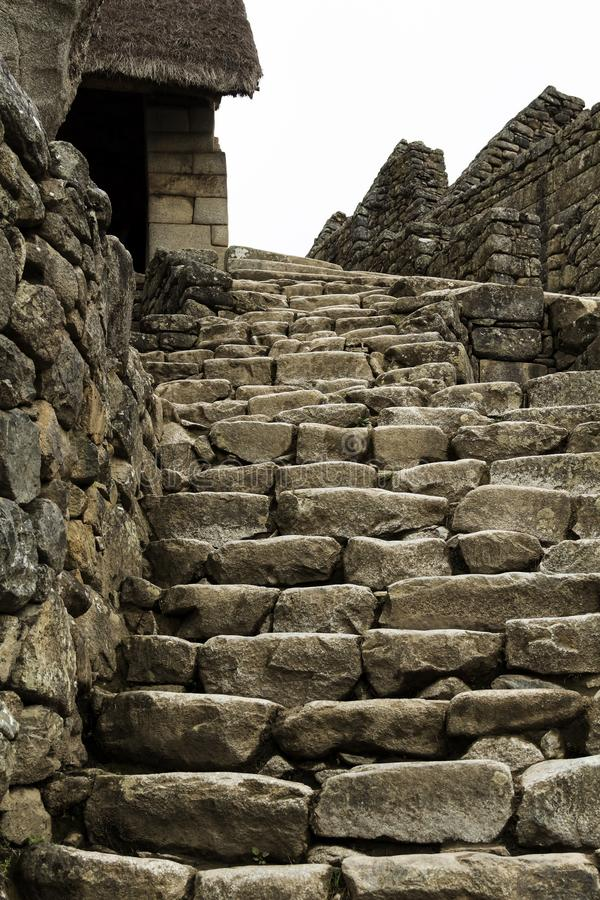 Stone Steps And Walls Machu Picchu Peru South America. Inca Stone Steps And Walls At Machu Picchu Peru With A Bit Of Thatched Roof Covering stock images