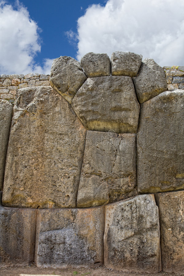 Inca wall. Fragment of stone wall in the shape of puma's paw. Inca fortress of Sacsayhuaman near Cusco, Peru royalty free stock photos