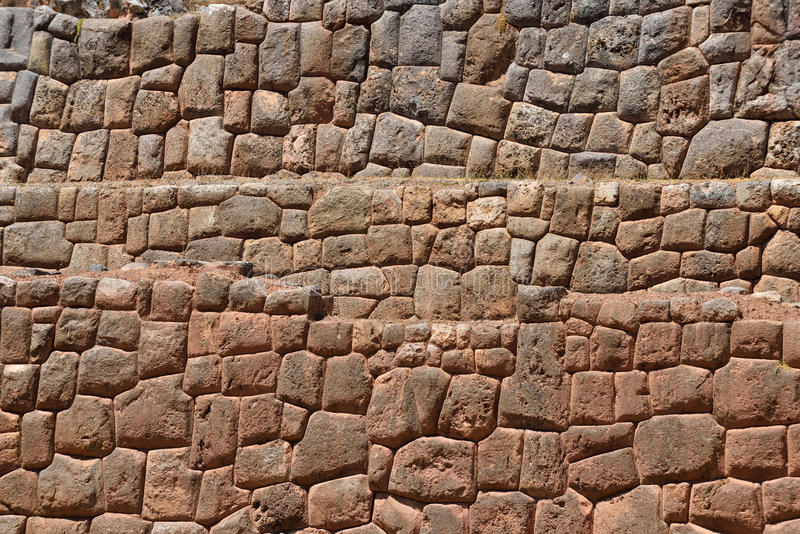 Inca wall in the village Chinchero, Peru. South America royalty free stock photo