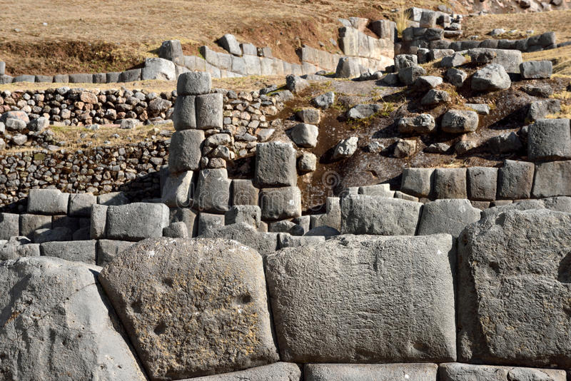 Inca wall in the village Saksaywaman, Peru. South America royalty free stock images
