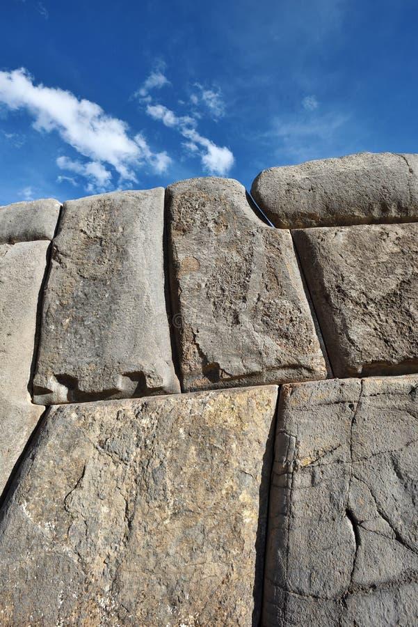 Inca wall in the village Saksaywaman Peru. Inca wall in the village Saksaywaman, Peru, South America stock photos