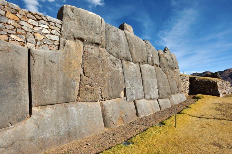 Inca wall in the village Saksaywaman Peru. Inca wall in the village Saksaywaman, Peru, South America stock image