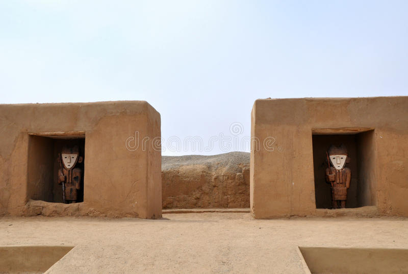 Incan Statues at Chan Chan. City entrance guarded by statues at Chan Chan archaeological site royalty free stock photo