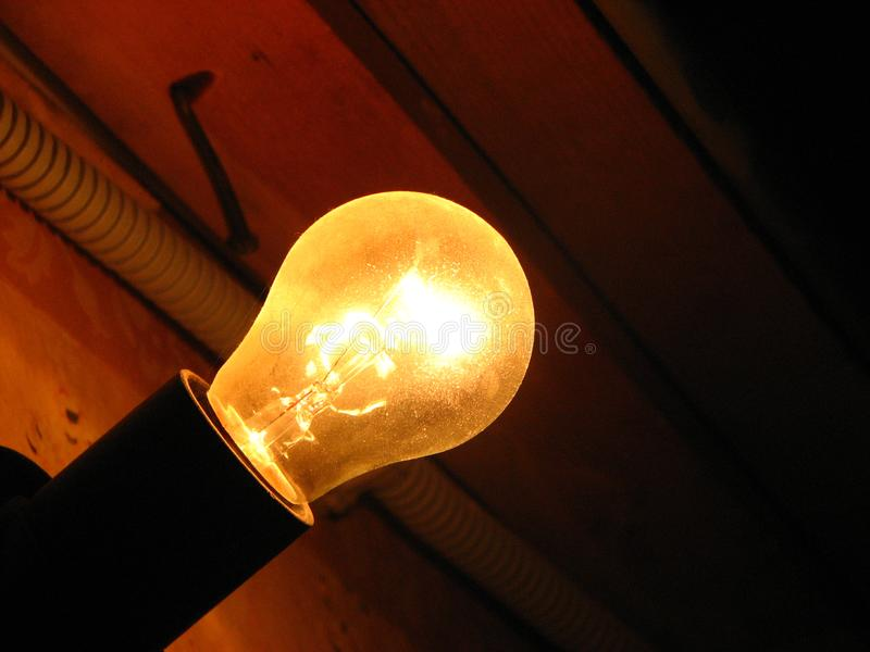 Incandescent bulb shines brightly royalty free stock photo