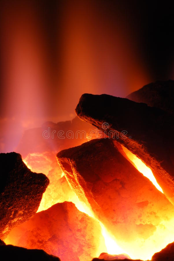 Incandescent coal. In color contrast stock photos