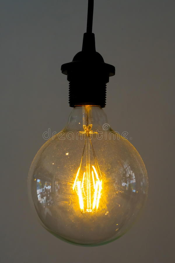 Incandescent lamps. In a modern cafe royalty free stock photography