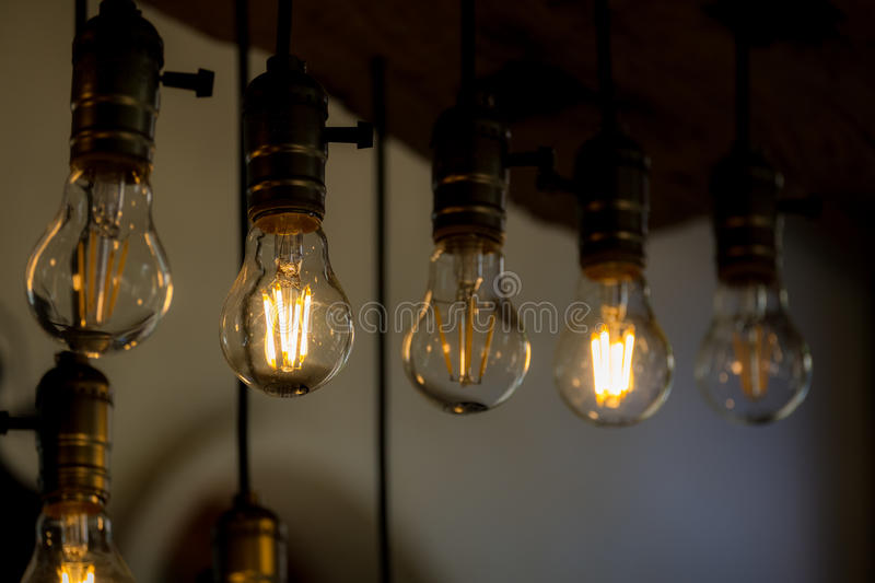 Incandescent light bulb in the row. With on-off switched royalty free stock images