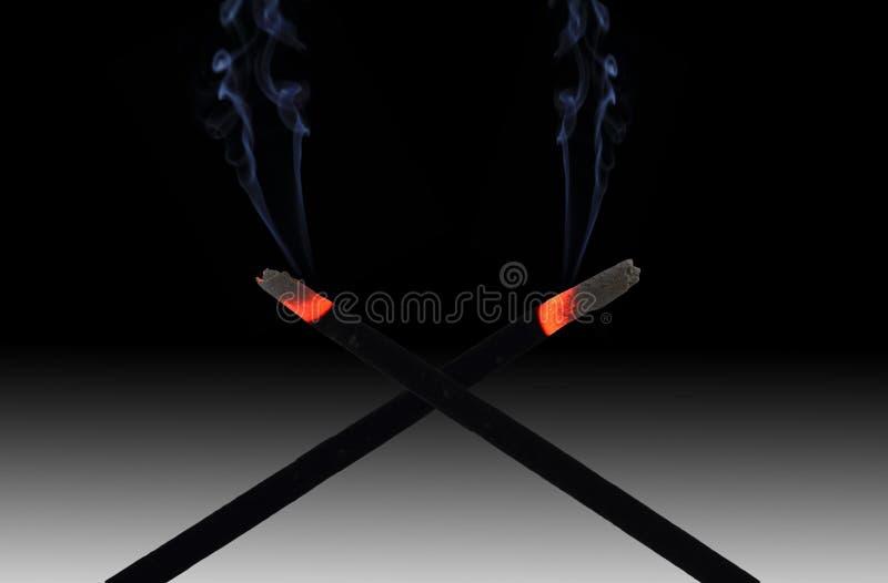 Incense sticks and smoke royalty free stock photos