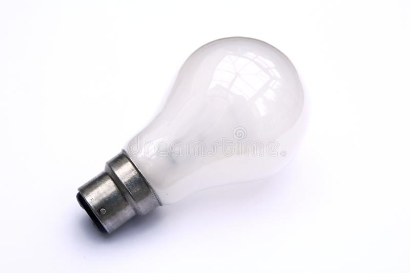 Incandescent tungsten pearl B22 bayonet fitting light bulb on white.  royalty free stock images