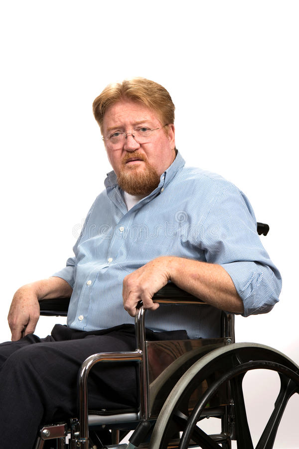 Incapacidades del hombre en silla de ruedas imagen de archivo libre de regalías