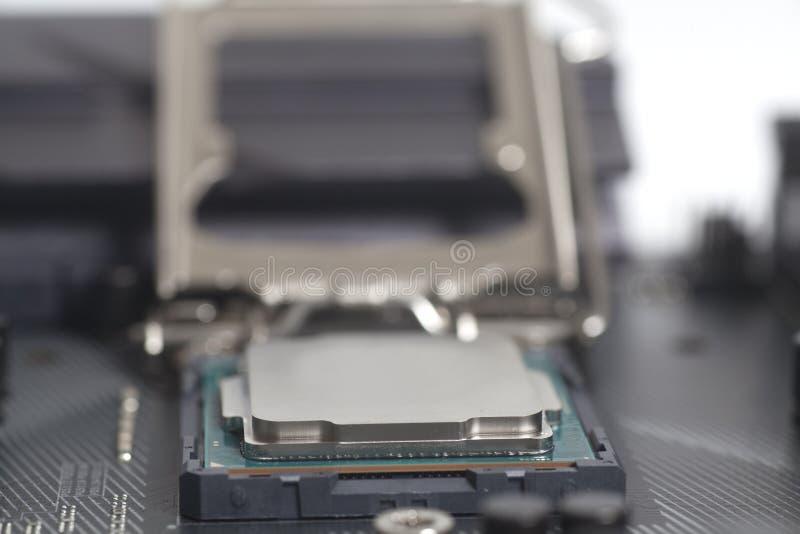 Incavo 1151 del CPU di Intel LGA sul PC del computer della scheda madre con l'unità di elaborazione fotografia stock libera da diritti