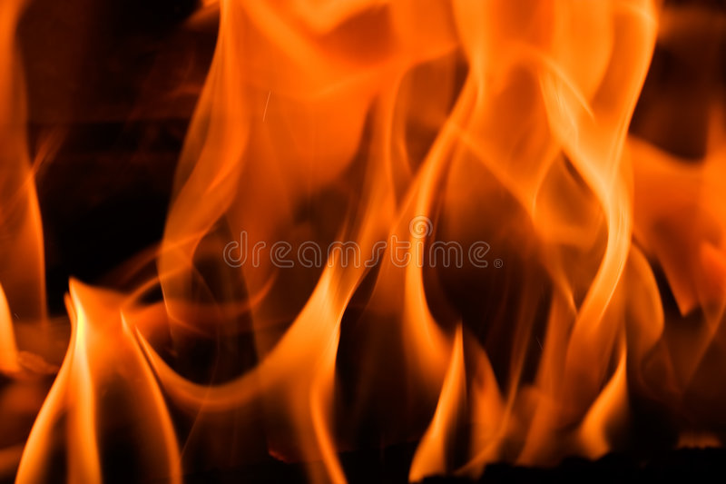 Incendie dans une cheminée photo stock