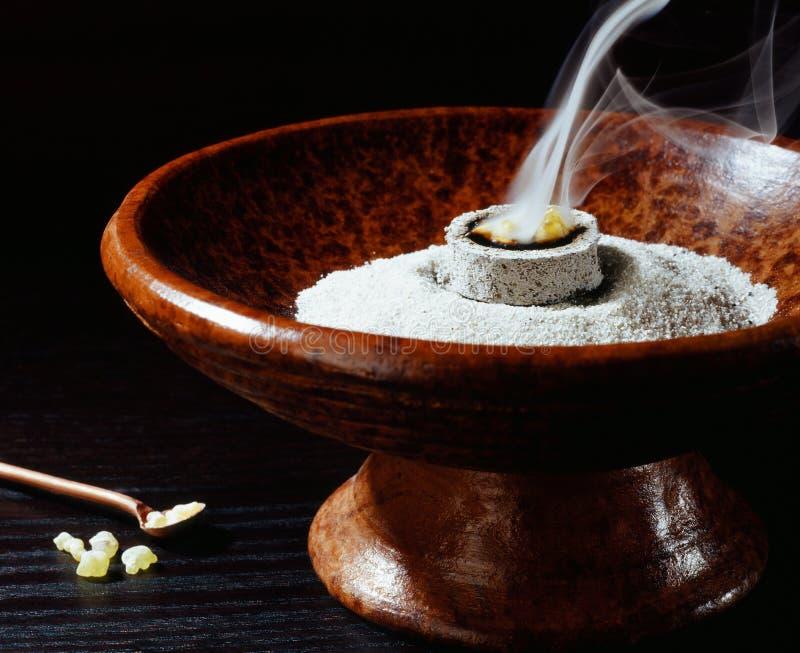 Incense bowl. And burning incense stock photo