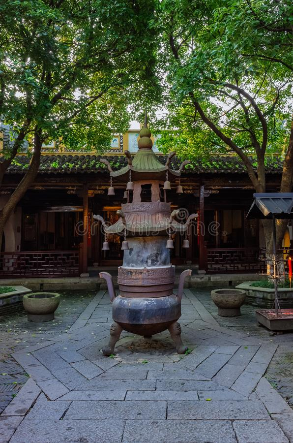Incense burner in the courtyard of a temple under trees, in tthe old town of Xitang, China. Large incense burner in the courtyard of a temple under trees, in royalty free stock photo