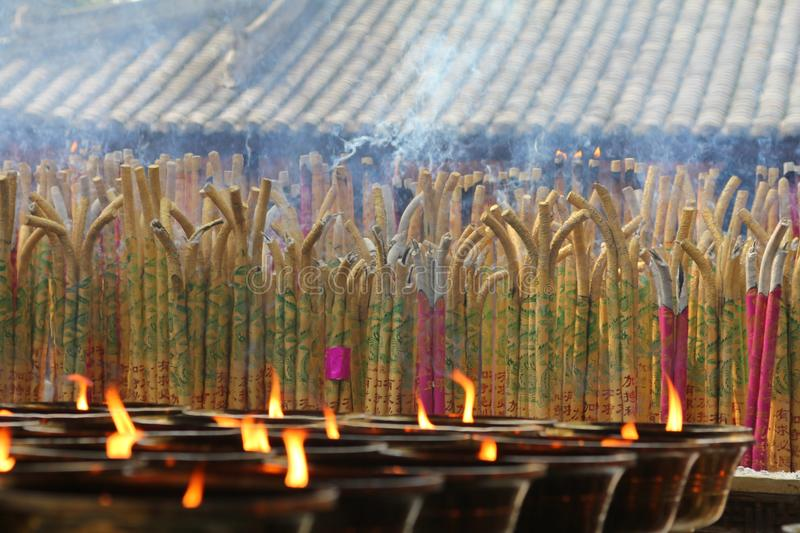 Incense burning in a temple, with candles stock photos