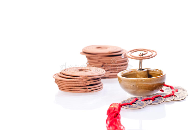 Incense Coil Burning With Old Chinese Coins Stock Photography