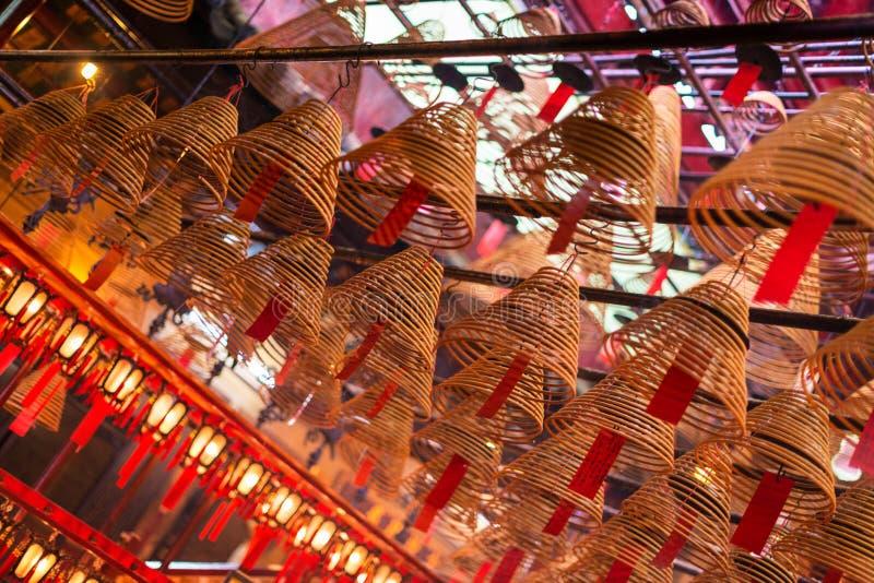 Incense coils and wishes at Man Mo Temple, Hong Kong stock image