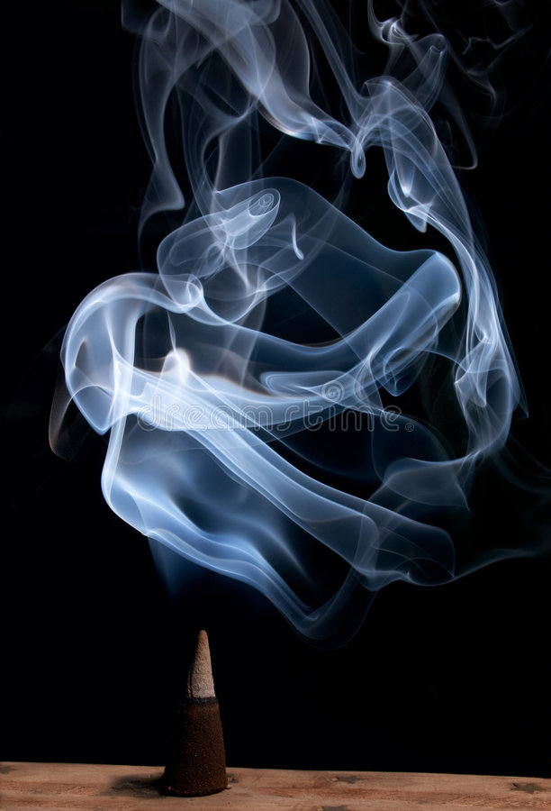 Incense cone with smoke stock photo