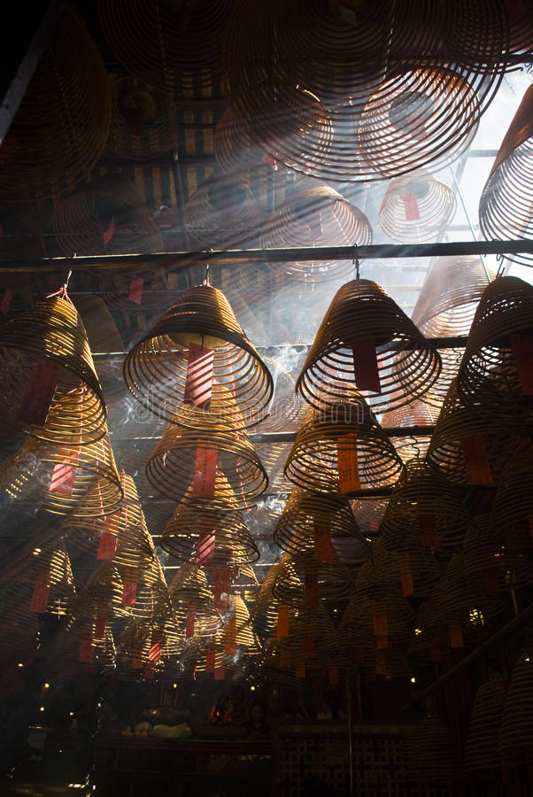 Incense and crepuscular rays in Man mo temple stock photo
