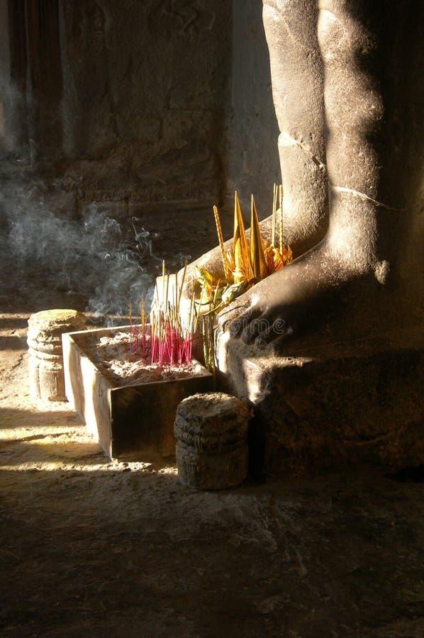 Incense at feet, Angkor stock images