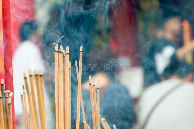 Incense joss stick burning slowly with fragrant smell smoke. People praying on Chinese Buddhist temple on Chinese new year, Luna n stock photos