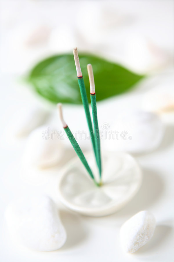 Incense, Leaf and Stones. Incense sticks, one green leaf, and white stones stock photos