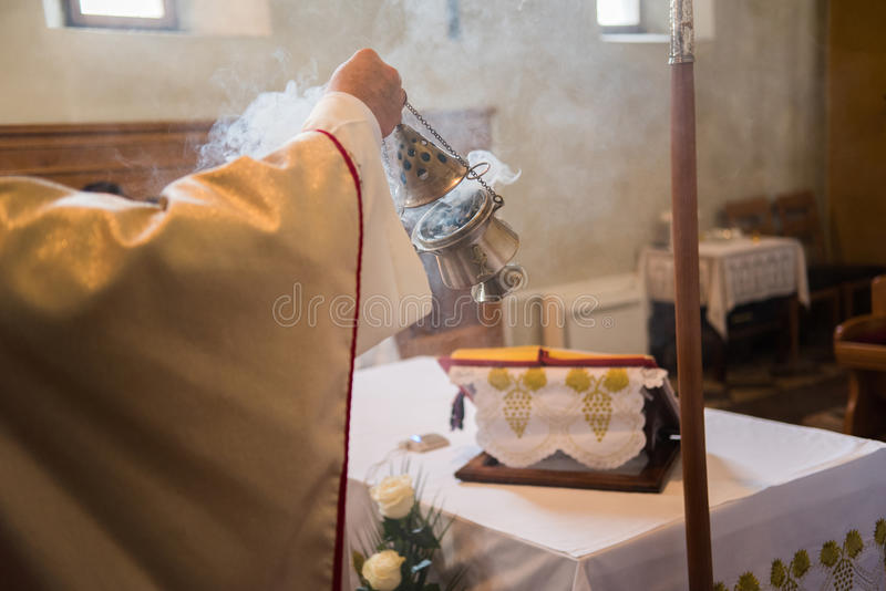 Incense during Mass. At the altar royalty free stock image