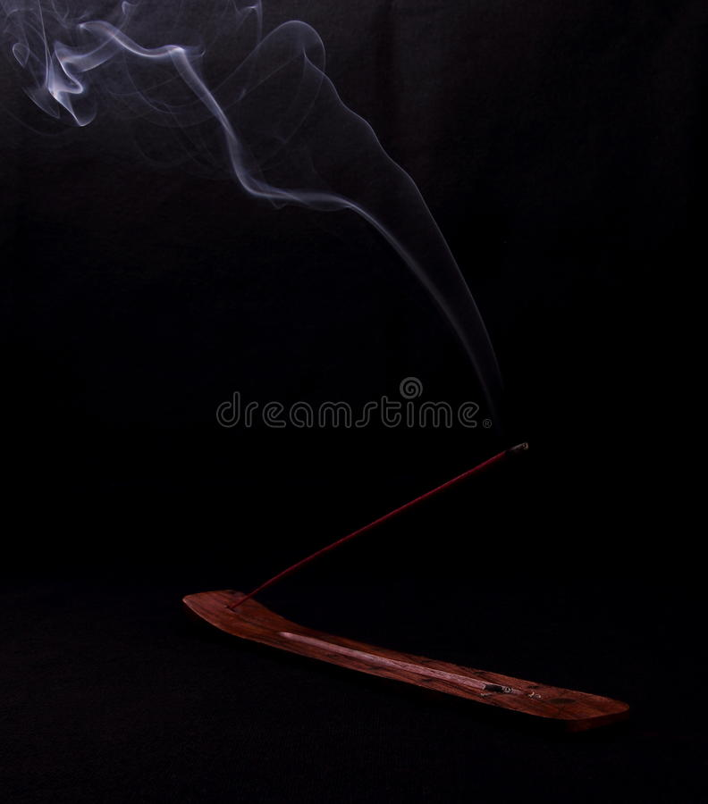 Incense and mystery smoke on black background. Vertical stock images