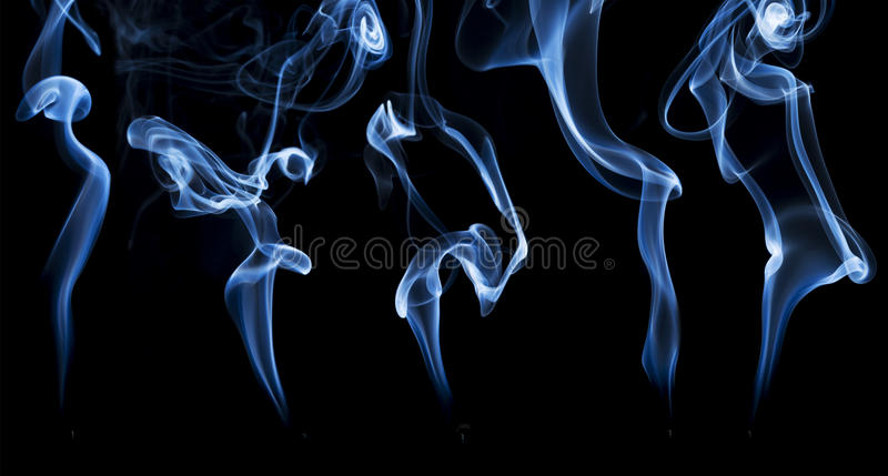 Incense smoke abstract. Delicate smoke from a burning incense stiick, a collage of five plumes stock photography