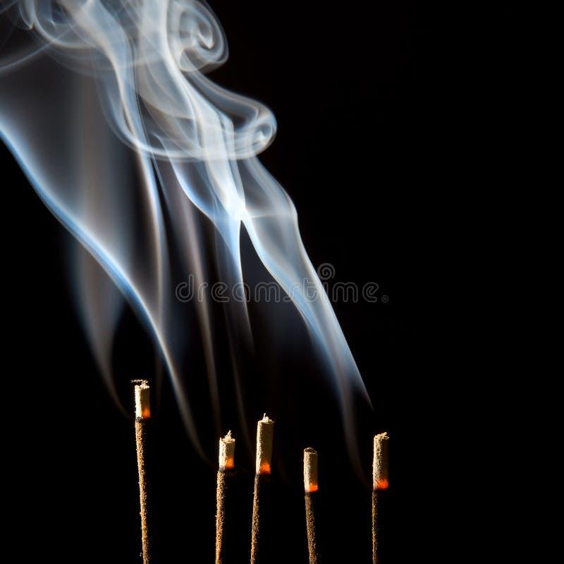Incense smoke wisps royalty free stock images